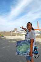 USA, Chicago, August 25, 2009.   Carolina Macias talks about the Celotex clean-up site, possible home for a much-needed park. The Little Village Environmental Justice Organization, headquartered in a predominantly Mexican-American neighborhood of Chicago, campaigns not only against pollution but for clean power, park facilities, urban agriculture, and restoring public transit. LVEJO's staff and volunteers make significant outreach and education efforts, especially for youth. Photo for an HOY feature story by Jay Dunn.