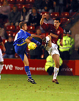 Photo: Dave Linney.<br />Walsall v Torquay United. Coca Cola League 2. 04/11/2006. Walsall's Scott Dann(R) in high kicking action at Bescot with  Steve Woods