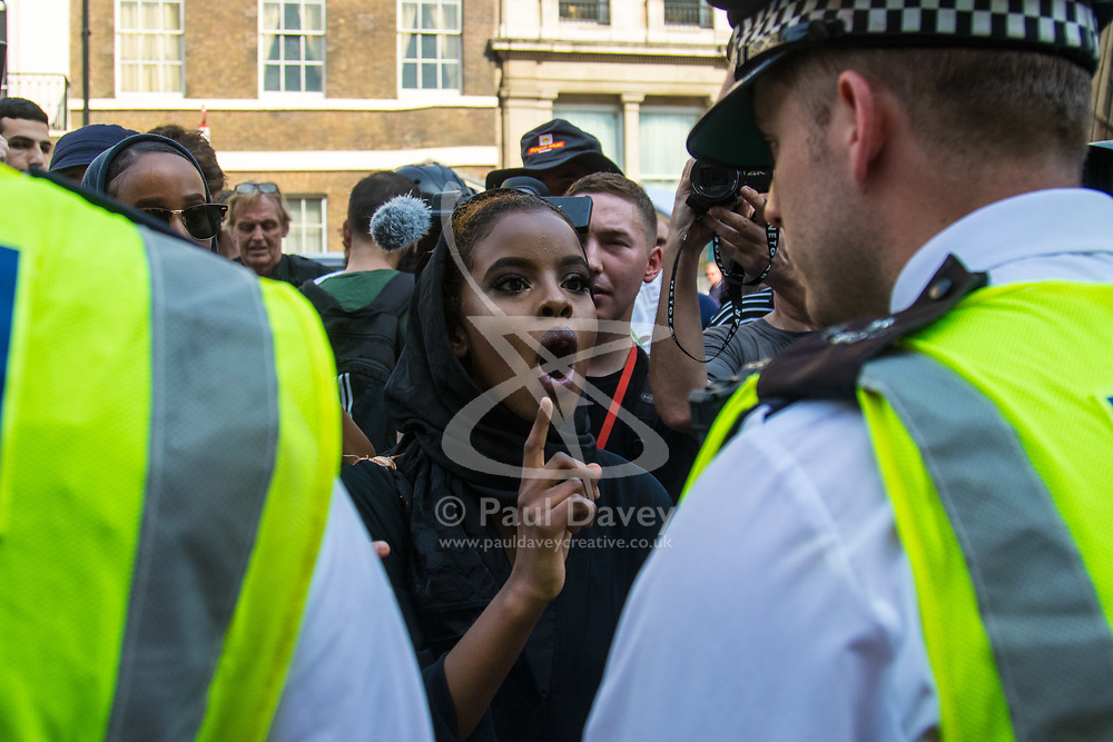London, June 21st 2017. Protesters march through London from Sheherd's Bush Green in what the organisers call 'A Day Of Rage' in the wake of the Grenfell Tower fire disaster. The march is organised by the Movement for Justice By Any Means Necessary and coincides with the Queen's Speech at Parliament, the destination. PICTURED: A woman shouts at police officers following the arrest of a protester.