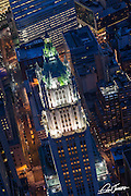 Aerial view of the Woolworth Building in NYC at dusk, photographed from a helicopter.