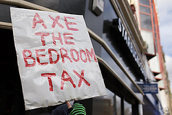 "© Licensed to London News Pictures . 16/03/2013 . Manchester , UK . Protesters outside Starbucks on Market Street chanting ""Pay your taxes"". Protesters opposed to changes to housing benefit , known as the Bedroom Tax , hold an impromptu (unsanctioned) march through Manchester City Centre today (16th March) . The government plans to introduce changes to housing benefit from this April which will see some claimants receive a reduced amount if they have excess living space . Photo credit : Joel Goodman/LNP"