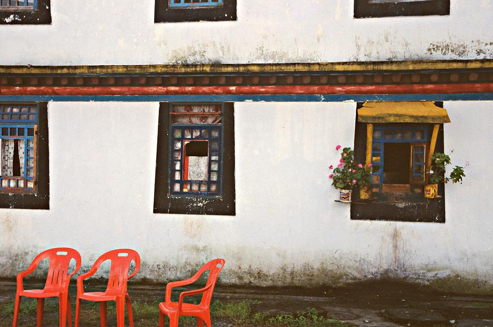 Red chairs at Rumtek monastery