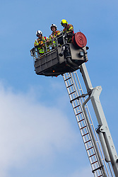 Firefighters use an aerial platform to assess the scene of a fire at The Mall in Walthamstow in North East London, that broke out during rush hour this morning and appears to have destroyed the foodcourt and according to a manager escorted by LFB officials at the adjacent Asda, a large amount of stock. London, July 22 2019.