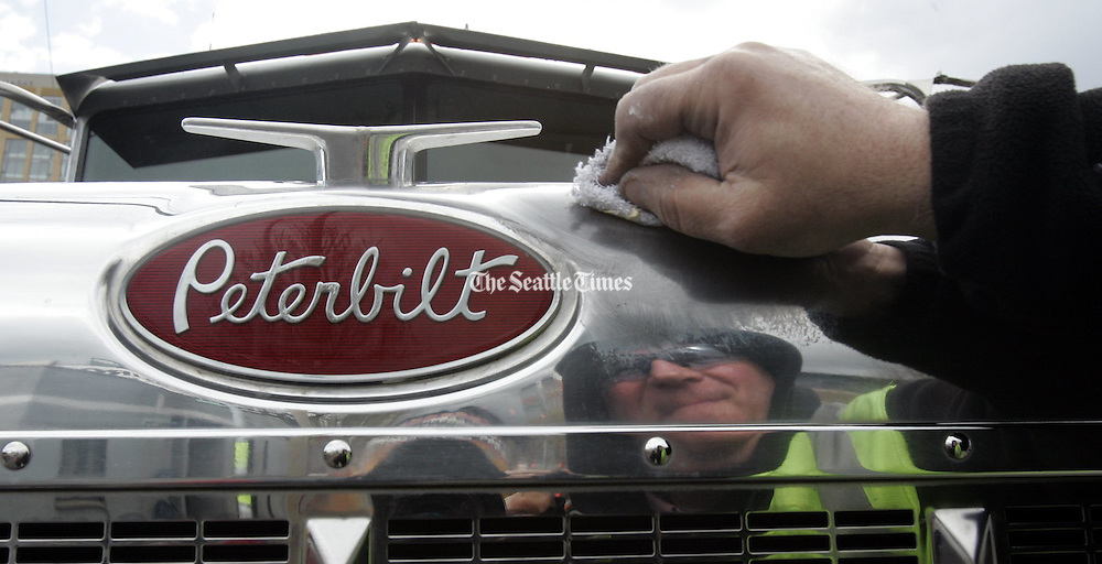 Rich Geraghty shining his Stoneway Concrete Peterbilt truck.<br /> <br /> Alan Berner / The Seattle Times