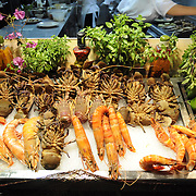 Seafood restaurant showcase in Rethymno, Crete (Greece). Jumbo shrimps, lobsters, sea fish and vegetables.