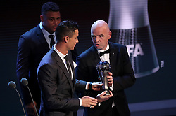 Gianni Infantino presents Cristiano Ronaldo the award for FIFA Men's Player of the Year during the Best FIFA Football Awards 2017 at the Palladium Theatre, London.