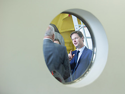 © Licensed to London News Pictures . 16/10/2014 . Stockport , UK . The Deputy Prime Minister , NICK CLEGG , arrives at the MAN Diesel factory in Stockport ahead of a cabinet meeting of the Local Growth Committee to be held at an office within the plant . Photo credit : Joel Goodman/LNP