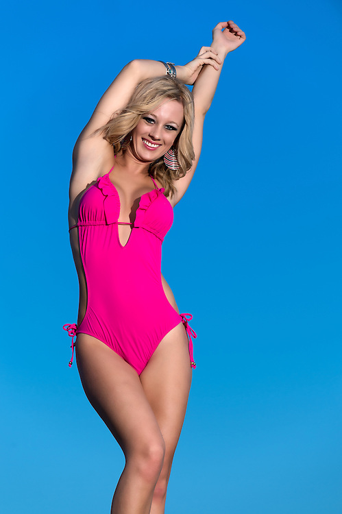 Woman very happy in swimsuit against blue sky or background.
