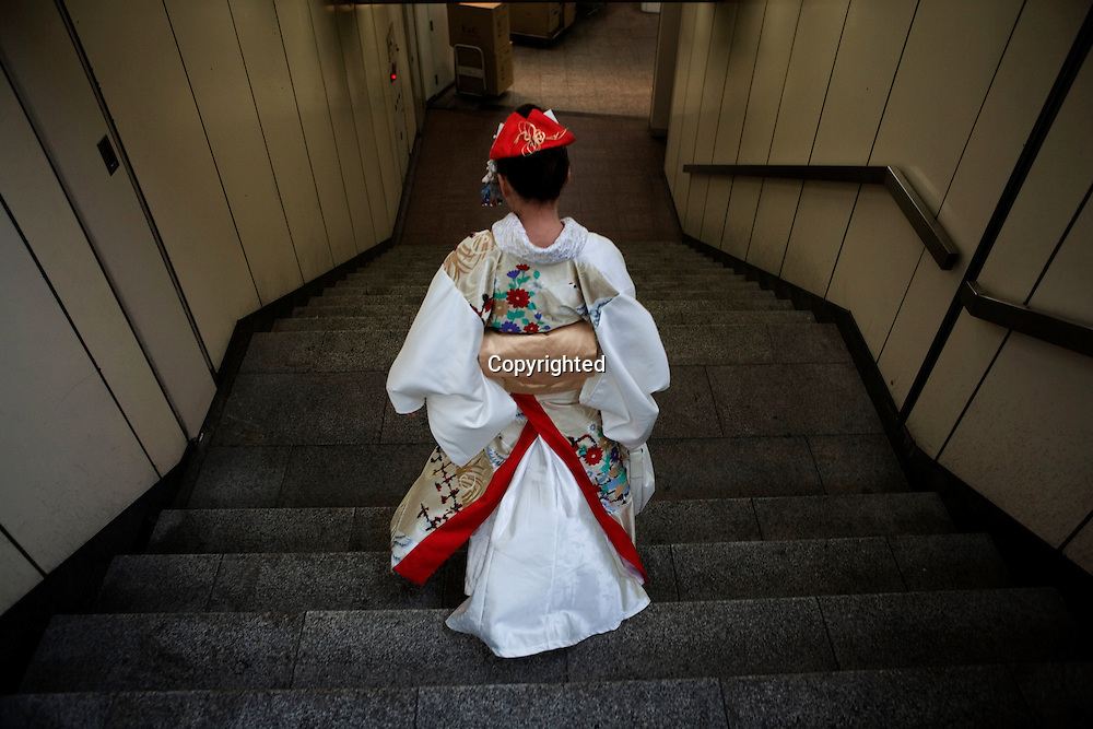 Tokyo's subway system dress, tradition