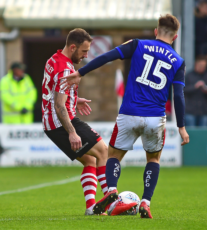 Lincoln City's Neal Eardley looks to turn Crewe Alexandra's Ryan Wintle<br /> <br /> Photographer Andrew Vaughan/CameraSport<br /> <br /> The EFL Sky Bet League Two - Lincoln City v Crewe Alexandra - Saturday 6th October 2018 - Sincil Bank - Lincoln<br /> <br /> World Copyright © 2018 CameraSport. All rights reserved. 43 Linden Ave. Countesthorpe. Leicester. England. LE8 5PG - Tel: +44 (0) 116 277 4147 - admin@camerasport.com - www.camerasport.com