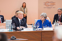 07 JUL 2017, HAMBURG/GERMANY:<br /> Donald Trump (L), Praesident Vereinigte Staatsn von America, USA, und Theresa May (R), Premierministerin Vereinigtes Koenigreich, Gross Britannien, waehrend der  1. Arbeitssitzung, G20 Gipfel, Messe<br /> IMAGE: 20170707-01-076<br /> KEYWORDS: G20 Summit, Deutschland