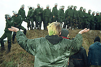 20.03.1998, Germany, Ahaus:<br /> Demonstrantin demonstriert Hilflosigkeit gegen das hohe Polizeiausgebot an der Bahnstrecke des Castor Transports nach Ahaus<br /> IMAGE: 19980320-01/02-31<br />  <br />  <br />  <br /> KEYWORDS: Demo, Demonstration, jugend, youth