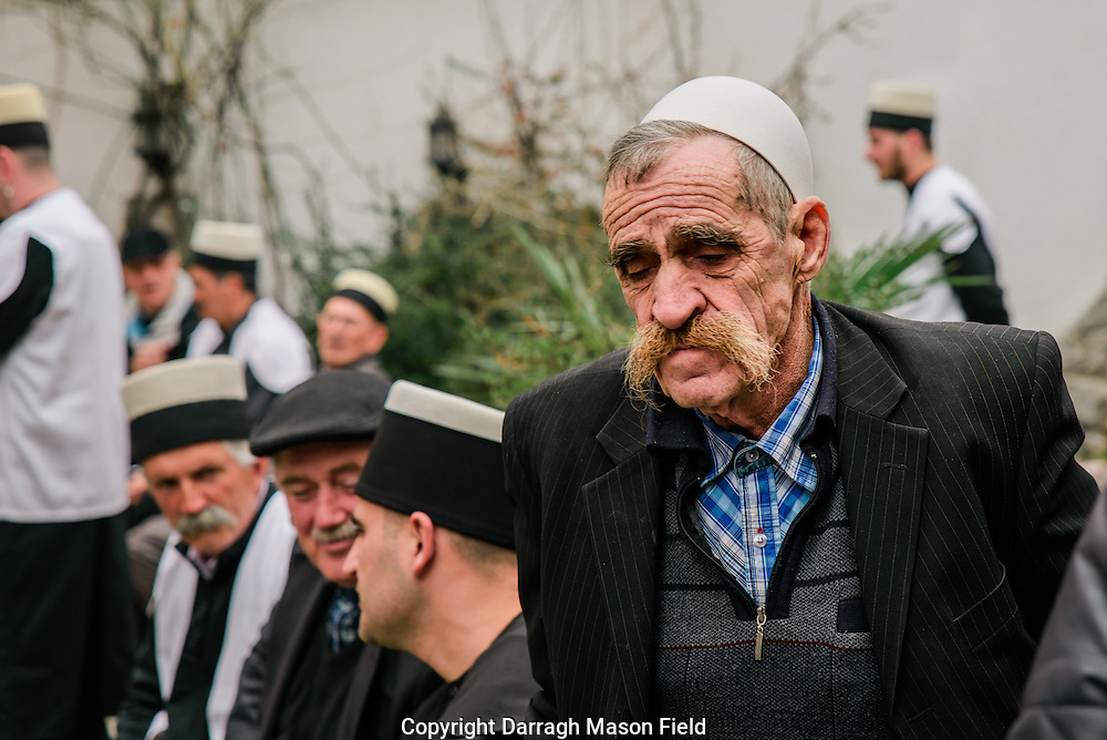 An elderly sufi in a traditional Albanian hat after the ritual.