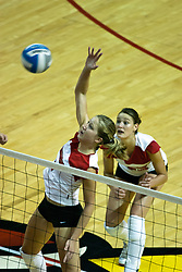 19 AUG 2006 Mary Catherine Richmond is high for a slam.  Northern Illinois Huskies got slammed by Illinois State Redbirds, losing the match 3 games to 1. Game action took place at Redbird Arena on the campus of Illinois State University in Normal Illinois.