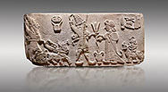 """Aslantepe Hittite Orthostat. Limestone, Aslantepe, Malatya, 1200-700 BC. Anatolian Civilizations Museum, Ankara, Turkey.<br /> <br /> Scene of offering drink and sacrifice. The god, with a symbol of divinity above, is in the chariot while holding a boomerang in his hand and a sword at his waist. The same god holds a lightning bundle in the middle. On the right, the king offers a drink to god. The inscription above reads """"Great, powerful King Sulumeli"""". A servant stands behind holding a bull for sacrifice to the gods. <br /> <br /> Against a gray background. .<br /> <br /> If you prefer to buy from our ALAMY STOCK LIBRARY page at https://www.alamy.com/portfolio/paul-williams-funkystock/hittite-art-antiquities.html . Type - Aslantepe - in LOWER SEARCH WITHIN GALLERY box. Refine search by adding background colour, place, museum etc.<br /> <br /> Visit our HITTITE PHOTO COLLECTIONS for more photos to download or buy as wall art prints https://funkystock.photoshelter.com/gallery-collection/The-Hittites-Art-Artefacts-Antiquities-Historic-Sites-Pictures-Images-of/C0000NUBSMhSc3Oo"""