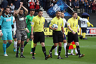 Referee Iain Williamson and his assistants Andrew Garratt and Andrew Halliday lead the teams out. Skybet football league one play off semi final, 1st leg match, Preston North End v Rotherham United at the Deepdale Stadium in Preston, England on Saturday 10th May 2014.<br /> pic by Chris Stading, Andrew Orchard sports photography.