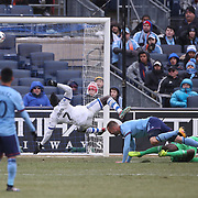 NEW YORK, NEW YORK - March 18: Dominic Oduro #7 of Montreal Impact scores his sides equalizing goal while challenged by Maxime Chanot #4 of New York City FC and goalkeeper Sean Johnson #1 of New York City FC during the New York City FC Vs Montreal Impact regular season MLS game at Yankee Stadium on March 18, 2017 in New York City. (Photo by Tim Clayton/Corbis via Getty Images)