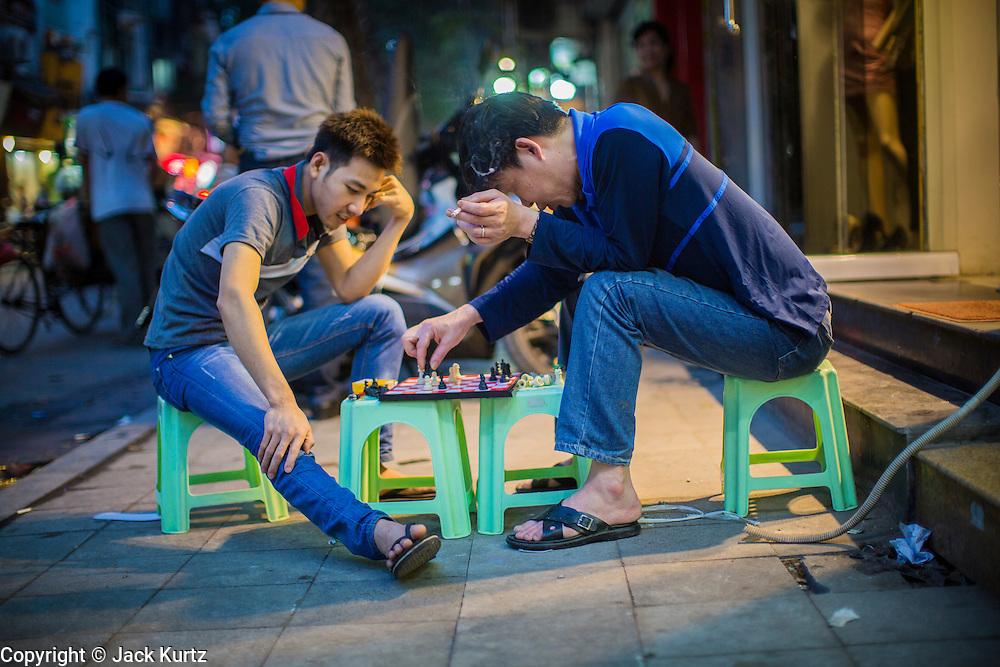 05 APRIL 2012 - HANOI, VIETNAM:   Men play chess on the street in Old Quarter of Hanoi, the capital of Vietnam.   PHOTO BY JACK KURTZ