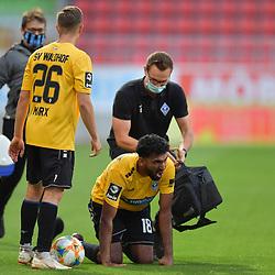 Spiel am 35 Spieltag in der Saison 2019-2020 in der 3. Bundesliga zwischen dem FC Ingolstadt 04 und dem SV Waldhof Mannheim am 24.06.2020 in Ingolstadt. <br /> <br /> Mohamed Gouaida (Nr.18, SV Waldhof Mannheim) wird verletzt am Boden behandelt, Jan-Hendrik Marx (Nr.26, SV Waldhof Mannheim) steht neben ihm<br /> <br /> Foto © PIX-Sportfotos *** Foto ist honorarpflichtig! *** Auf Anfrage in hoeherer Qualitaet/Aufloesung. Belegexemplar erbeten. Veroeffentlichung ausschliesslich fuer journalistisch-publizistische Zwecke. For editorial use only. DFL regulations prohibit any use of photographs as image sequences and/or quasi-video.