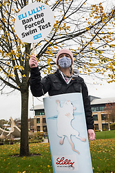 A PETA supporter wearing a costume depicting a beaker of water in which a mouse is struggling to stay afloat protests outside Eli Lilly's R&D centre to call on the US pharmaceutical company to ban the forced swim test on 29 October 2020 in Bracknell, United Kingdom. Animal rights charity PETA UK contends that the forced swim test during which small animals are dosed with an anti-depressant drug, placed in inescapable beakers filled with water and forced to swim to keep from drowning has been widely discredited and that other pharmaceutical companies including Johnson & Johnson, GlaxoSmithKline, Pfizer, Bayer, Roche and AstraZeneca have banned it.