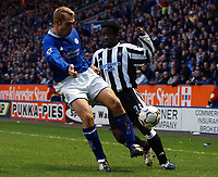 Photo. Matthew Lewis.<br />Leicester City v Newcastle United. FA Barclaycard Premiership. 26/12/2003.<br /><br />Leicester's James Scowcroft and Newcastle's  Olivier Bernard compete for the ball.