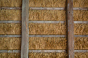 Thatched corn rafters of the Barn at the Rogatec Open Air Museum, very close to the Croatian border, on 24th June 2018, in Rogatec, Slovenia. The museum of relocated and restored 19th and early 20th century farming buildings and houses represents folk architecture in the area south of the Donacka Gora and Boc mountains.