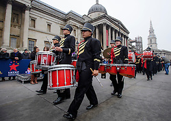 © Licensed to London News Pictures. 30/12/2016. London, UK. The Etiwanda High School Marching Band take part in a warmup event for New Years celebrations, at Trafalgar Square in London. Security will be increased across most UK New Year celebrations this year following the Berlin Christmas market terrorism attack.  Photo credit: Ben Cawthra/LNP