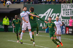 November 4, 2018 - Portland, OR, U.S. - PORTLAND, OR - NOVEMBER 04: Portland Timbers defender Jorge Vilafaña (4) and Seattle Sounders mifielder Victor Rodriguez (8) during the Portland Timbers first leg of the MLS Western Conference Semifinals against the Seattle Sounders on November 04, 2018, at Providence Park in Portland, OR. (Photo by Diego Diaz/Icon Sportswire) (Credit Image: © Diego Diaz/Icon SMI via ZUMA Press)