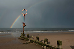 Portobello's beach octopus sculpture - Cressida - restored after the winter storms and a Spring showers rainbow.  © Jon Davey/ EEm