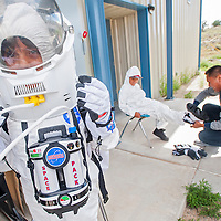 091813       Cable Hoover<br /> <br /> St. Bonaventure students Shelby Arviso, left, and Matthew Milliken try on space suits in the NASA Traveling Space Museum at Navajo Technical University in Crownpoint Wednesday.