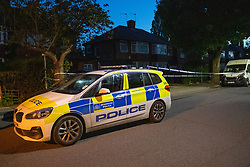 © Licensed to London News Pictures. 31/05/2021. London, UK. A police vehicle forms a small cordon on Booth Road following the fatal stabbing of an 18-year-old male at Montrose Park, Edgware. Metropolitan Police were called at 17:54 BST on Monday 31/05/2021 following reports of a group of males fighting. The man was found suffering from a stab injury in a tennis court area. He was treated by London's Air Ambulance and London Ambulance Service at the scene but was pronounced dead at 19:19 BST. Photo credit: Peter Manning/LNP