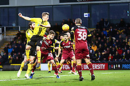 Burton Albion midfielder Jamie Allen (4) heads at goal during the EFL Sky Bet League 1 match between Burton Albion and Bradford City at the Pirelli Stadium, Burton upon Trent, England on 26 January 2019.