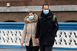 © Licensed to London News Pictures. 14/03/2020. London, UK. Tourists wearing medical masks walk across Tower Bridge this afternoon. The coronavirus is continuing to spread across Europe and the UK and today Spain is reportedly in lockdown for all non essential travel. Photo credit: Vickie Flores/LNP