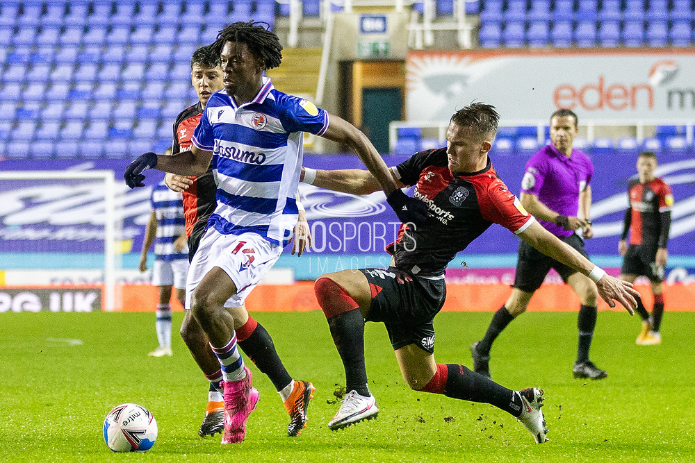 Coventry City defender Leo Ostigard (2) battles for possession with Reading midfielder Ovie Ejaria (14) during the EFL Sky Bet Championship match between Reading and Coventry City at the Madejski Stadium, Reading, England on 19 January 2021.