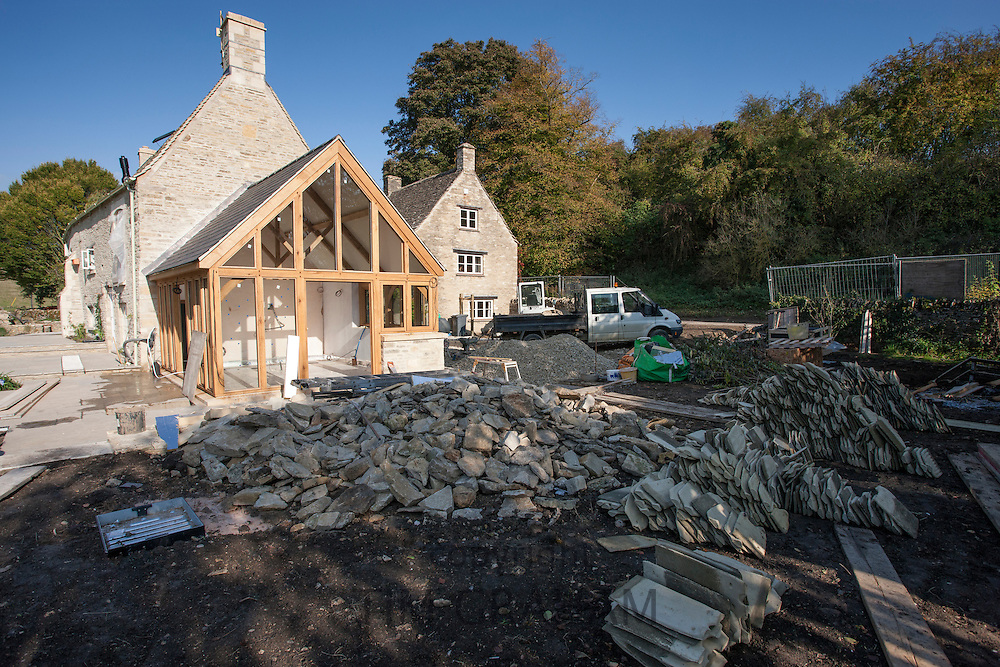Renovation project restoring 17th Century Cotswold stone cottage and oak barn extension to gable end, the Cotswolds, UK