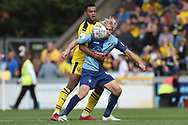 Wycombe Wanderers striker Craig Mackail-Smith (9) battles for possession  with Oxford United defender Curtis Nelson (5) during the EFL Sky Bet League 1 match between Wycombe Wanderers and Oxford United at Adams Park, High Wycombe, England on 15 September 2018.