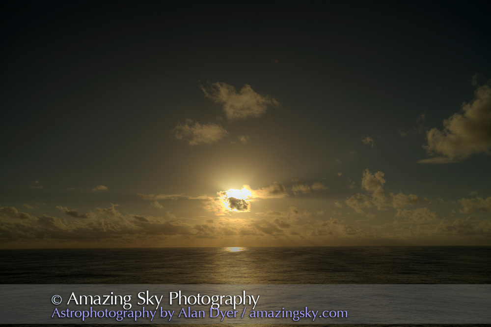 Partially eclipsed Sun in clouds, just before totality, July 21, 2009. With Canon 5DMkII and 16-35mm lens.