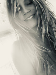 """Heidi Klum releases a photo on Twitter with the following caption: """"""""Hello Monday 😊❤️"""""""". Photo Credit: Twitter *** No USA Distribution *** For Editorial Use Only *** Not to be Published in Books or Photo Books ***  Please note: Fees charged by the agency are for the agency's services only, and do not, nor are they intended to, convey to the user any ownership of Copyright or License in the material. The agency does not claim any ownership including but not limited to Copyright or License in the attached material. By publishing this material you expressly agree to indemnify and to hold the agency and its directors, shareholders and employees harmless from any loss, claims, damages, demands, expenses (including legal fees), or any causes of action or allegation against the agency arising out of or connected in any way with publication of the material."""