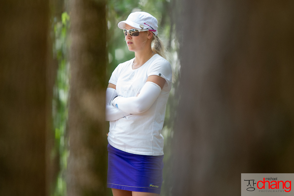 April 27 2012: Finland's Minea Blomqvist reflects about her shot from the woods on the 18th hole during the Mobile Bay LPGA Classic at Magnolia Grove in Mobile, AL.