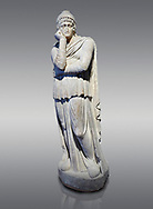 Roman statue of Arris, 3rd century AD from Hierapolis. Hierapolis Archaeology Museum, Turkey. Against a grey background .<br /> <br /> If you prefer to buy from our ALAMY STOCK LIBRARY page at https://www.alamy.com/portfolio/paul-williams-funkystock/greco-roman-sculptures.html- Type - Hierapolis - into LOWER SEARCH WITHIN GALLERY box - Refine search by adding a subject, place, background colour, museum etc.<br /> <br /> Visit our CLASSICAL WORLD HISTORIC SITES PHOTO COLLECTIONS for more photos to download or buy as wall art prints https://funkystock.photoshelter.com/gallery-collection/The-Romans-Art-Artefacts-Antiquities-Historic-Sites-Pictures-Images/C0000r2uLJJo9_s0c