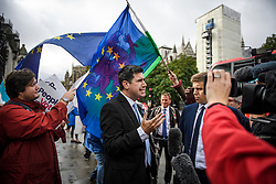 © Licensed to London News Pictures. 25/09/2019. London, UK. Labour MP RICHARD BURGON talks to media, outside the Houses of Parliament in Westminster on the day that MPs return. The Supreme Court in London yesterday ruled that Parliament had been suspended illegally after British Prime Minster Boris Johnson prorogued parliament just weeks before the UK is due to leave the EU on October 31st. Photo credit: Ben Cawthra/LNP