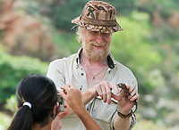 British herpetologist Mark O'Shea holds a tokay gecko, Gekko gecko, while American student Marianna Tucci photographs it, in the Liquica district of Timor-Leste (East Timor). Both are participating in an ongoing survey of Timorese reptiles and amphibians.