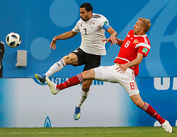 June 19, 2018 - Saint Petersburg, Russia - Iury Gazinsky (R) of Russia national team and Ahmed Fathi of Egypt national team vie for the ball during the 2018 FIFA World Cup Russia group A match between Russia and Egypt on June 19, 2018 at Saint Petersburg Stadium in Saint Petersburg, Russia. (Credit Image: © Mike Kireev/NurPhoto via ZUMA Press)