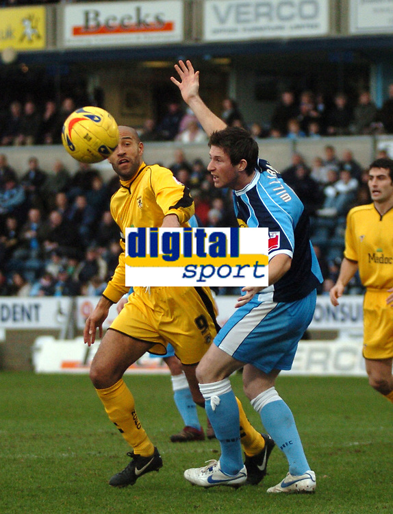 Photo: Tony Oudot.<br />Wycombe Wanderers v Notts County. Coca Cola League 2. 10/02/2007.<br />Leon Crooks of Wycombe clears from Jason Lee of Notts County