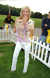NORMANDIE KEITH with her dogs Sugar & Lotti at the Macmillan Cancer Relief Dog Day held at the Royal Hospital Chelsea South Grounds, London on 6th July 2004.