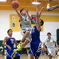 020515      Cayla Nimmo<br /> <br /> Thoreau Hawk Montana Miller (4) makes a basket over the head of Zuni Thunderbird Matthew Tsabetsaye (20) in the game at Thoreau high school Thursday.