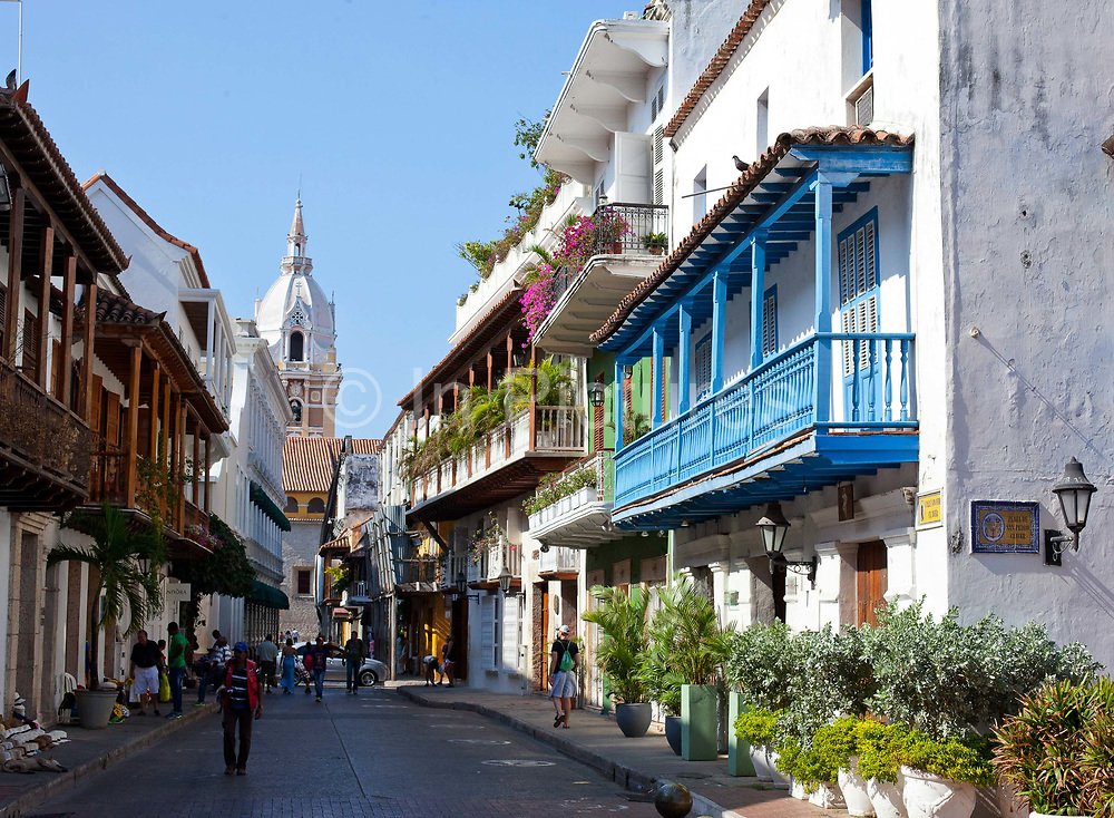 Street scene inside the old town of Cartagena city, showing the well preserved Colonial architecture. Cartagena was formed as a port town in 1533, it is a UNESCO World heritage site, the capital of Bolivar department, and is located on the north coast of Colombia in the Caribbean Coast Region, Colombia.