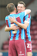 Murray Wallace of Scunthorpe United and Scott Laird of Scunthorpe United celebrate their win  at end of match during the Sky Bet League 1 match between Scunthorpe United and Shrewsbury Town at Glanford Park, Scunthorpe, England on 17 October 2015. Photo by Ian Lyall.