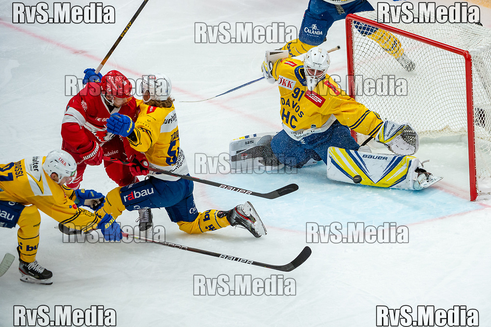 LAUSANNE, SWITZERLAND - SEPTEMBER 24: Lukas Frick #38 of Lausanne HC tries to score against Goalie Gilles Senn #91 of HC Davos during the Swiss National League game between Lausanne HC and HC Davos at Vaudoise Arena on September 24, 2021 in Lausanne, Switzerland. (Photo by Robert Hradil/RvS.Media)