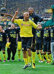 30.04.2011, Signal Iduna Park, Dortmund, GER, 1.FBL,  Borussia Dortmund vs 1. FC Nuernberg, im Bild Leonardo de Deus Santos Dede (Dortmund BRA #17) feiert und tanzt auf dem Platz, hinter ihm ist Felipe Santana (Dortmund BRA #27) und dahinter weitere spieler der Mann schaft im Hintergrund, EXPA Pictures © 2011, PhotoCredit: EXPA/ nph/  Scholz       ****** out of GER / SWE / CRO  / BEL ******